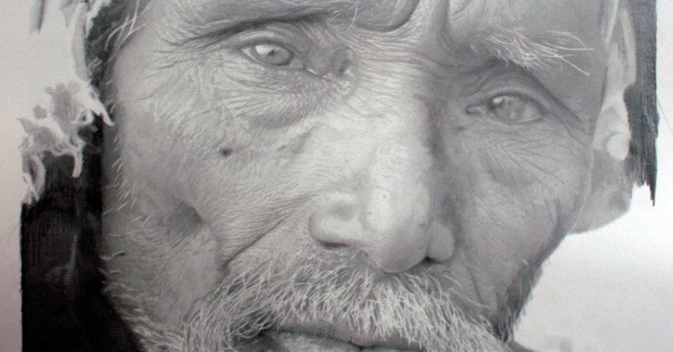 O artista escocês hiper-realista Paul Cadden recria fotos a lápis ou grafite com detalhamento surpreendente